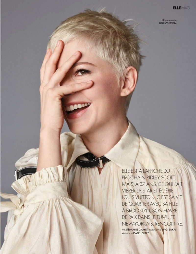 Flashing a smile, Michelle Williams shows off her pixie haircut
