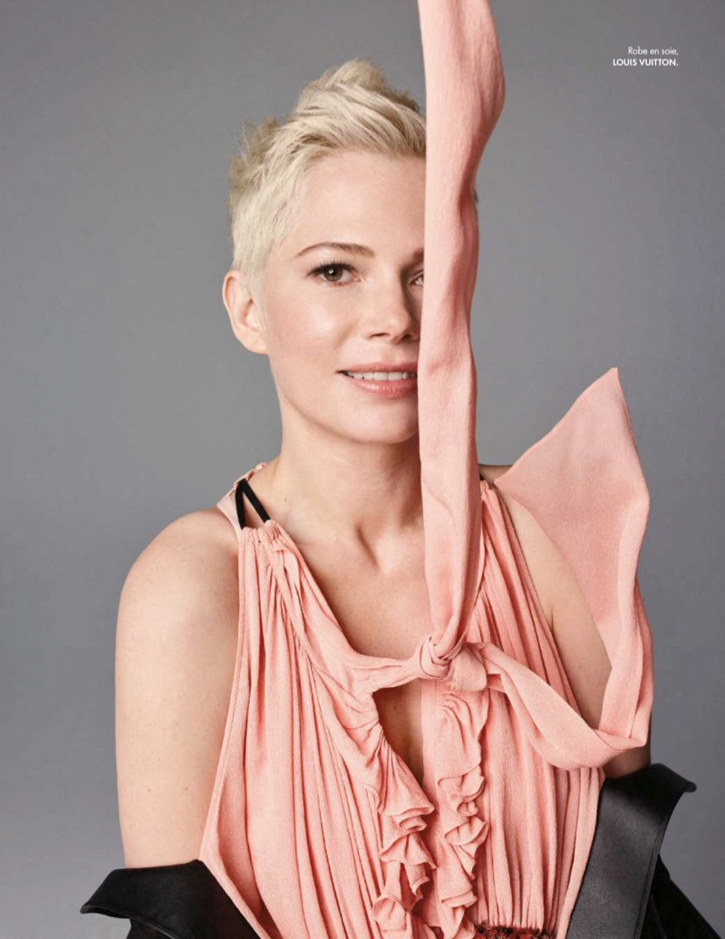 Wearing pink, Michelle Williams poses in Louis Vuitton dress
