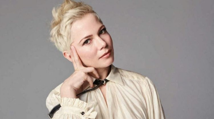 Striking a pose, Michelle Williams wears Louis Vuitton blouse and pants