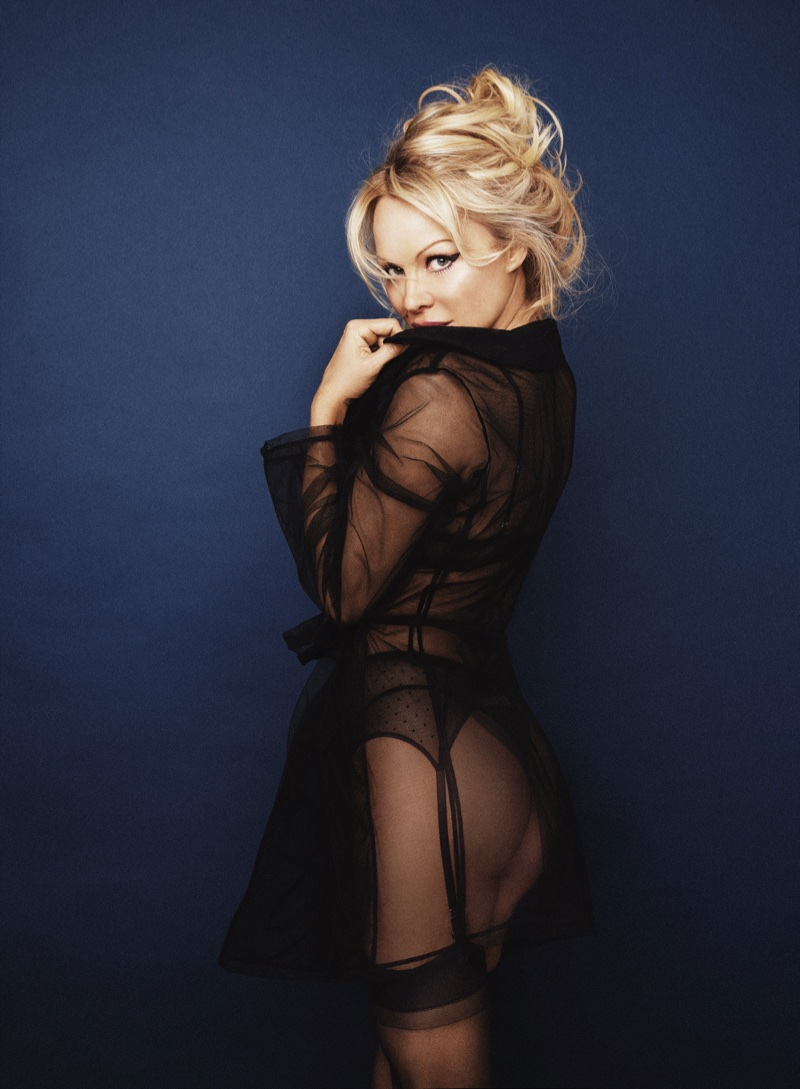 Wearing a sheer trench coat, Pamela Anderson models Pamela Loves Coco de Mer collection. Photo: Rankin/The Full Service for Coco de Mer