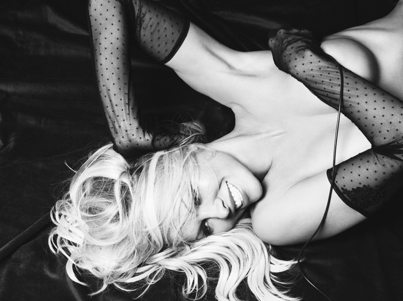 Pamela Anderson poses topless in black and white shot. Photo: Rankin/The Full Service for Coco de Mer