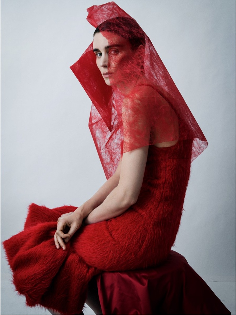 Actress Rooney Mara poses in red Prada dress