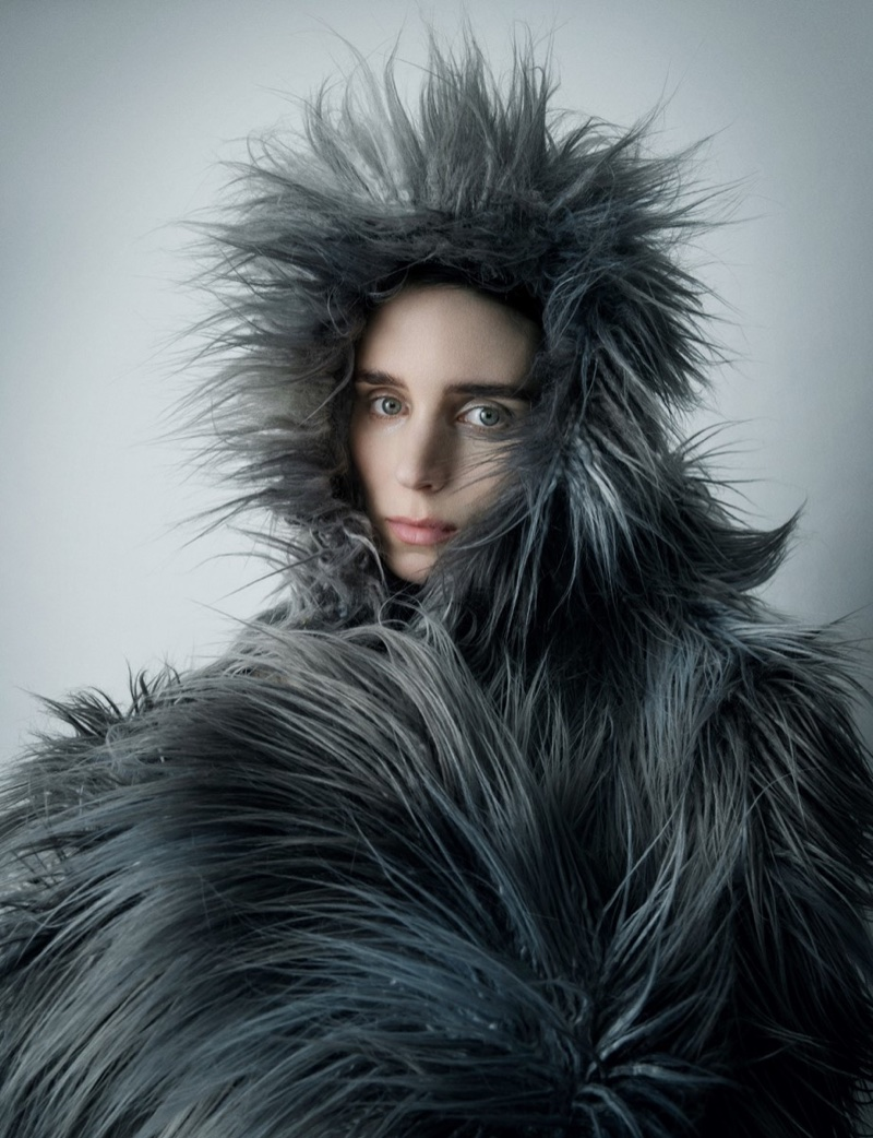 Covering up, Rooney Mara poses in fur coat