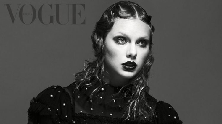 Photographed in black and white, Taylor Swift wears embroidered sweater
