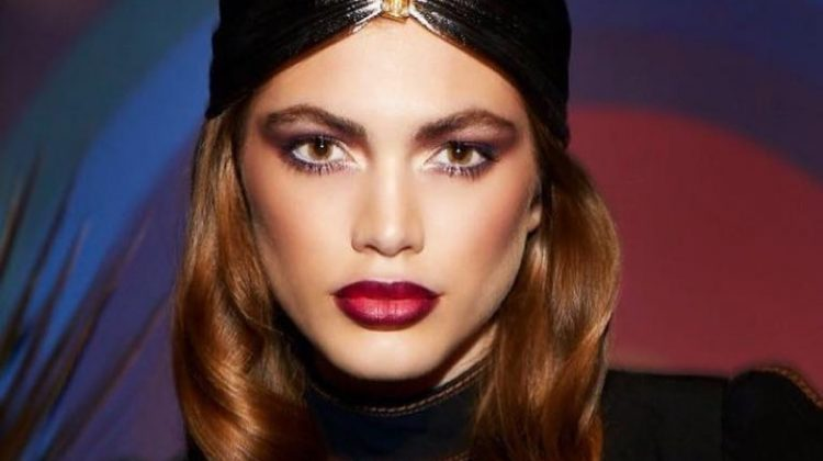 Model Valentina Sampaio wears a bold red lip color from Marc Jacobs Beauty