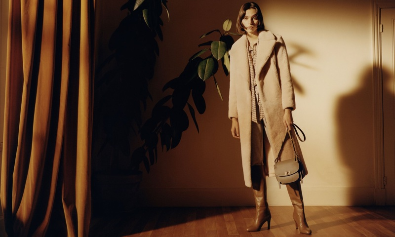 Charlee Fraser poses in luxe coat for Bally's spring-summer 2018 campaign