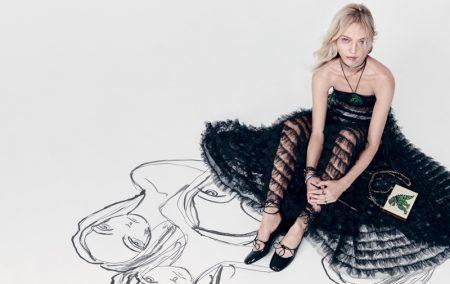 Model Sasha Pivovarova wears black dress in Dior's spring-summer 2018 campaign