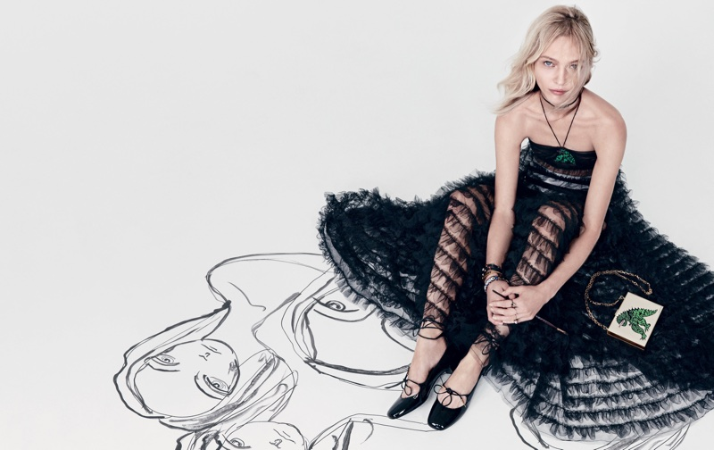 Model Sasha Pivovarova wears black dress in Dior's spring-summer 2018 campaign