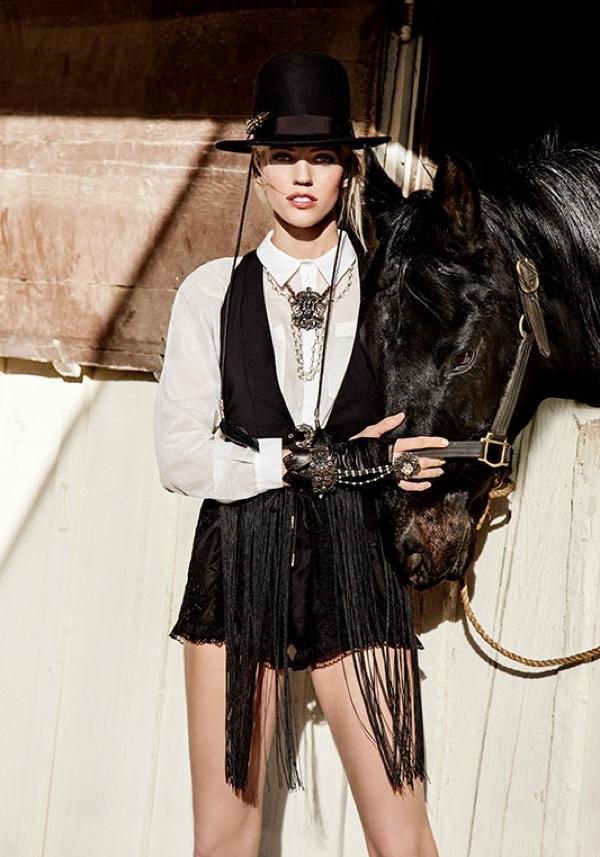 Devon Windsor poses with a horse for Elisabetta Franchi's spring-summer 2018 campaign