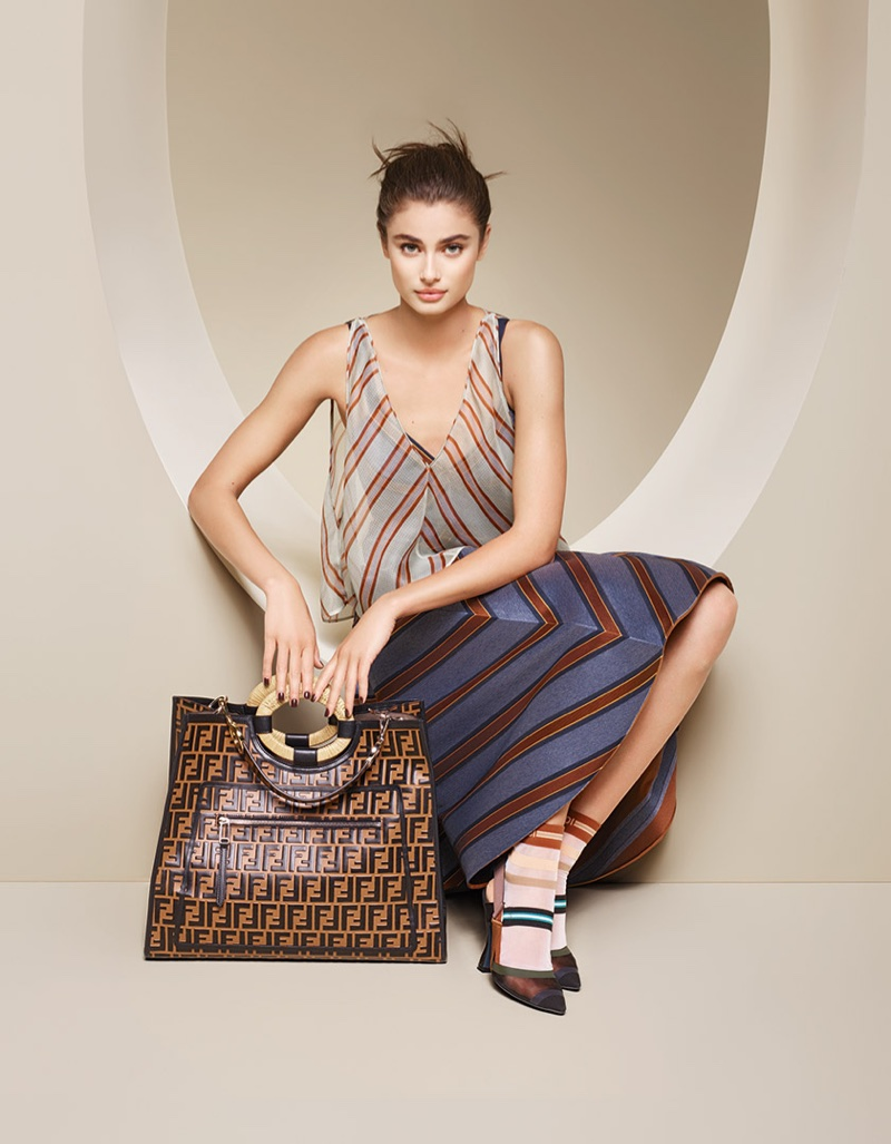 Model Taylor Hill poses in stripes for Fendi's spring-summer 2018 campaign
