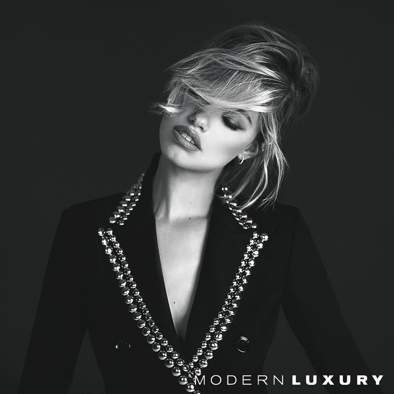 Hailey Clauson wears John Galliano blazer with Anita Ko earrings