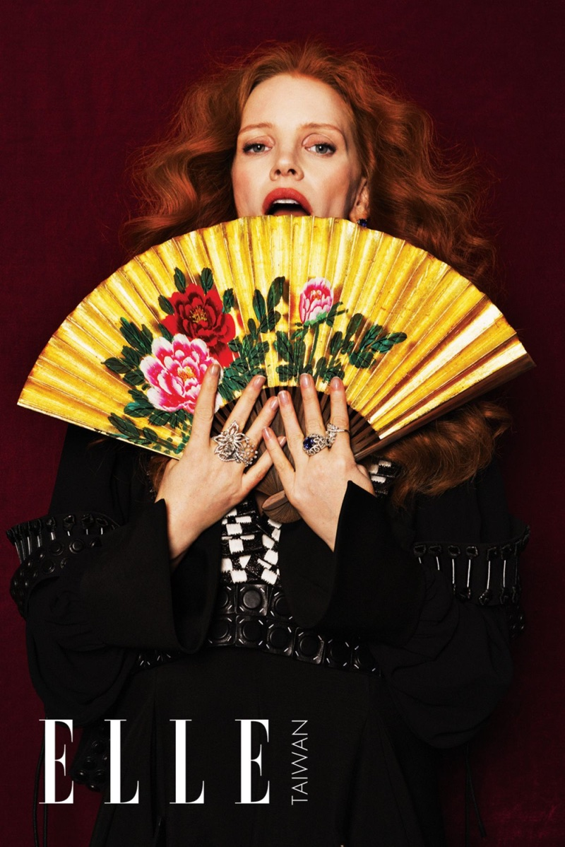 Posing with a printed fan, Jessica Chastain looks fashion forward