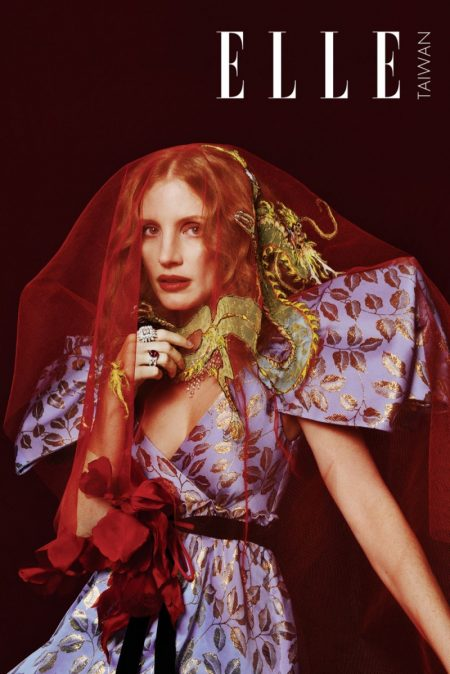 Covered in red veil, Jessica Chastain wears Gucci gown