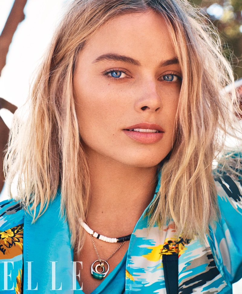 Margot Robbie wears a wavy hairstyle
