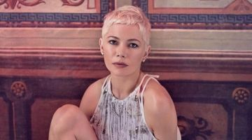 Posing barefoot, Michelle Williams wears a Louis Vuitton dress