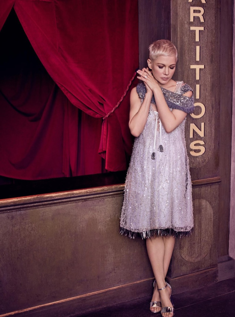 Actress Michelle Williams strikes a pose in Louis Vuitton dress