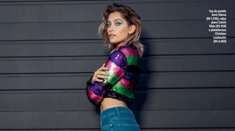 Paris Jackson poses in Amir Slama sequin top, Calvin Klein jeans and Christian Louboutin sandals