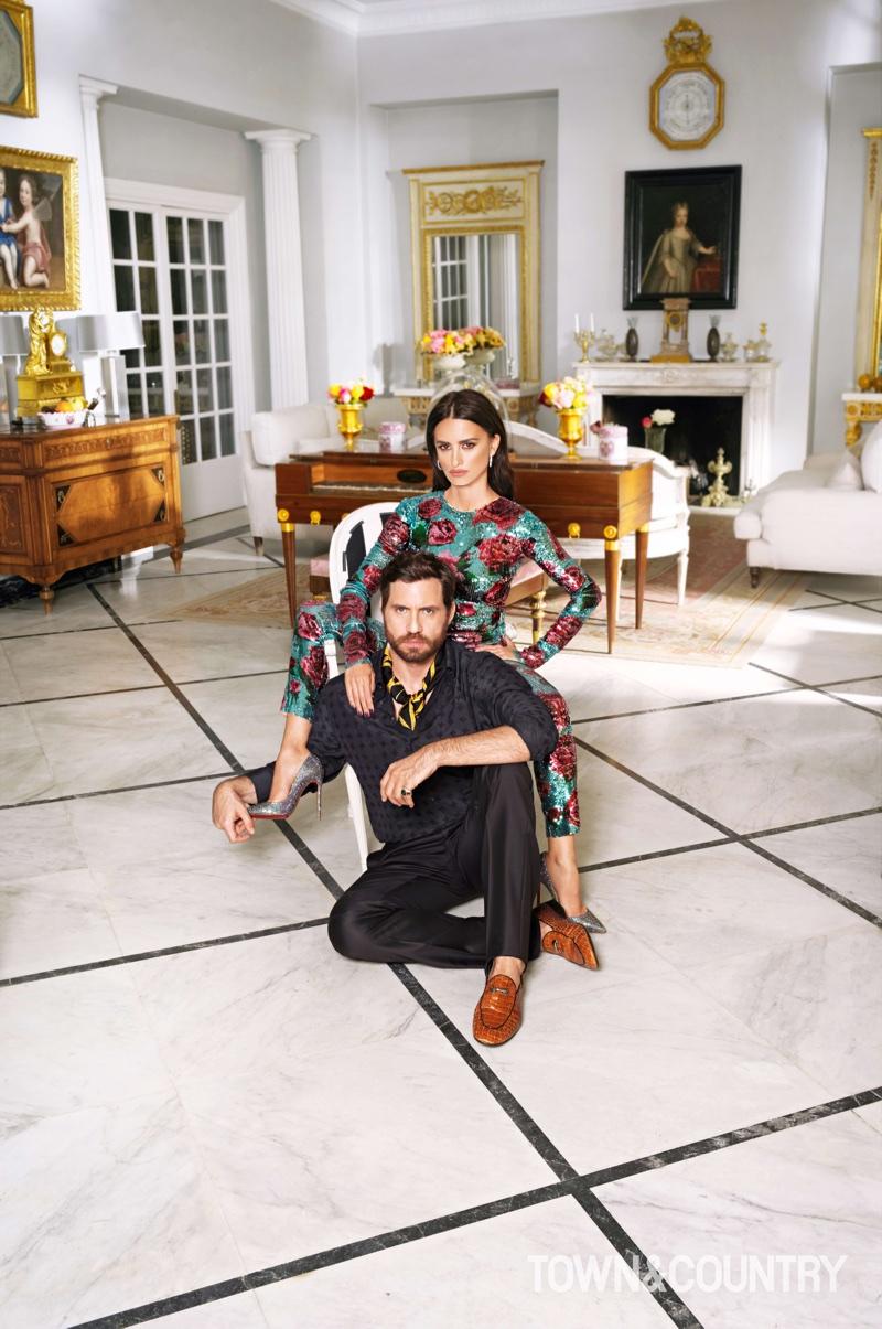 Penelope Cruz wears Dolce & Gabbana jumpsuit with Christian Louboutin heels. Edgar Ramirez poses in Armani shirt and pants with Giuseppe Zanotti loafers.