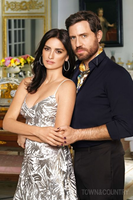 Penelope Cruz wears silver Michael Kors Collection dress and Chopard earrings. Edgar Ramirez poses in Dior Homme shirt.