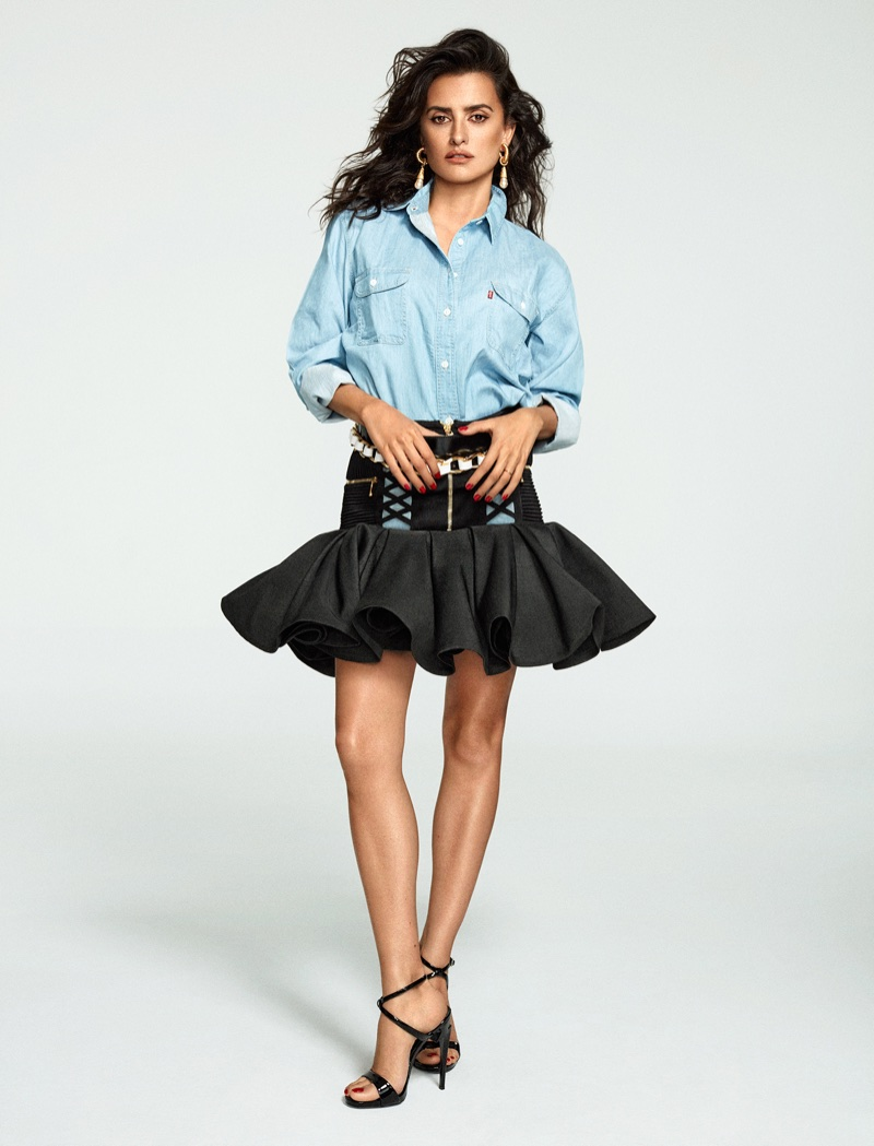 Penelope Cruz wears Levi's shirt with Balmain skirt and Giuseppe Zanotti heels