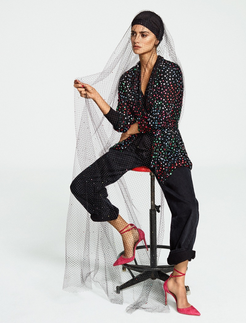 Penelope Cruz poses in Giorgio Armani hat, jacket and pants with Aquazzura heels