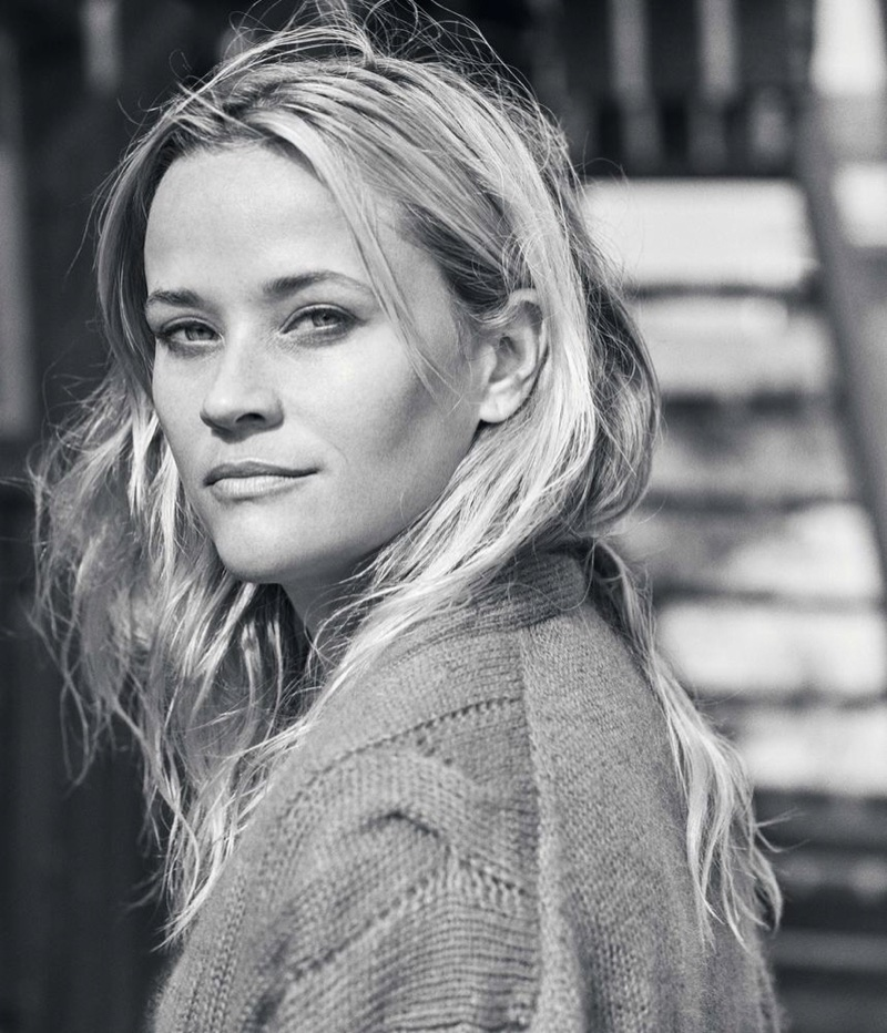 Photographed in black and white, Reese Witherspoon poses in a Gucci sweater