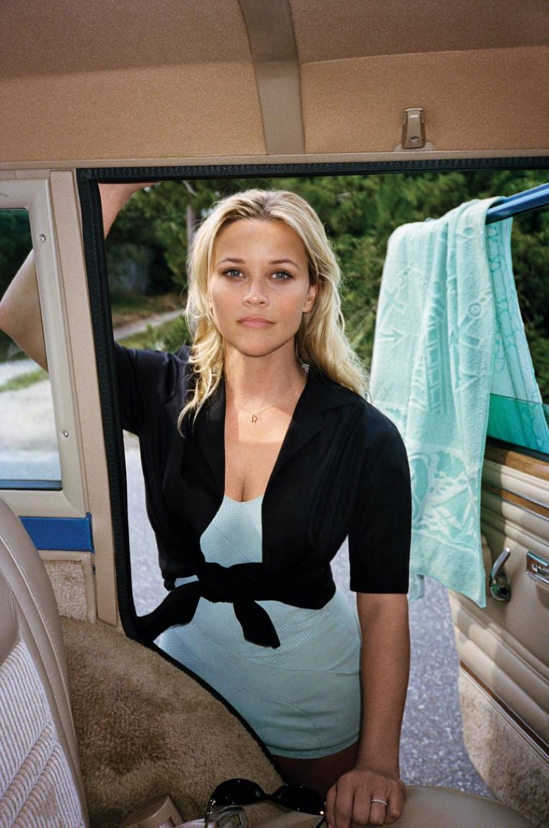 Actress Reese Witherspoon poses in Narciso Rodriguez shirt, vintage swimsuit and Jennifer Fisher necklace