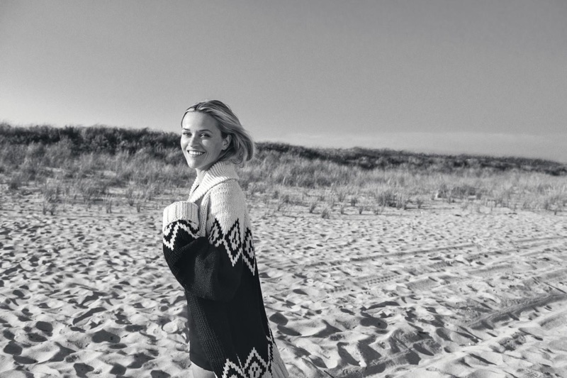 Posing at the beach, Reese Witherspoon wears Marc Jacobs sweater