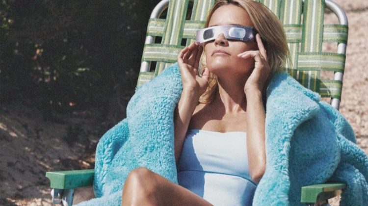 Reese Witherspoon soaks up the sun in Burberry coat and Jean Yu swimsuit