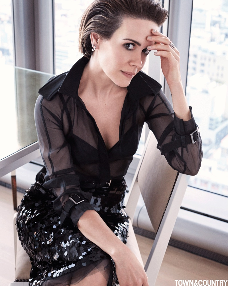 Dressed in black, Sarah Paulson wears Max Mara shirt, Eres Bra and No. 21 skirt