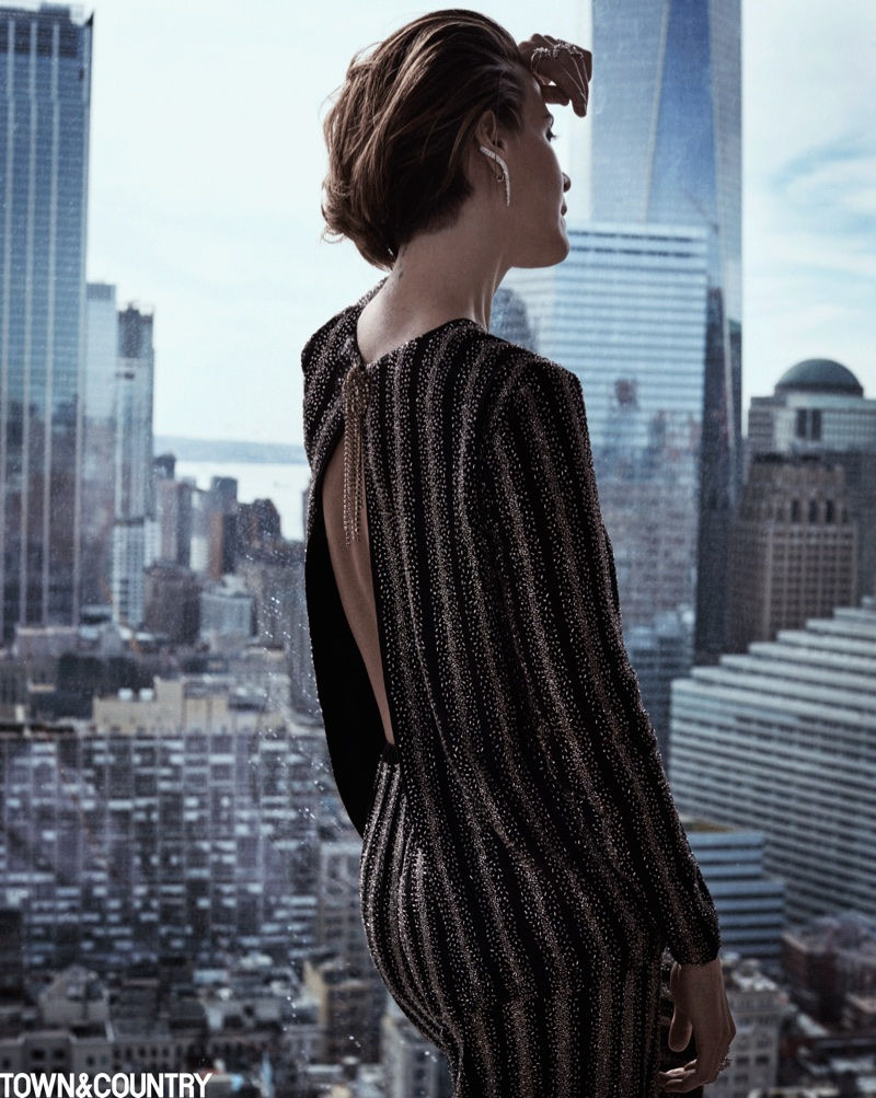 Flaunting her back, Sarah Paulson poses in Dries van Noten shirt and pants with Yeprem jewelry