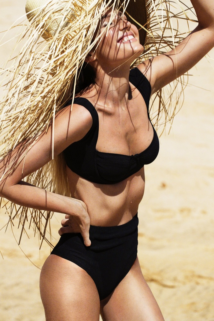 Candice Swanepoel models Tropic of C swimsuit collection