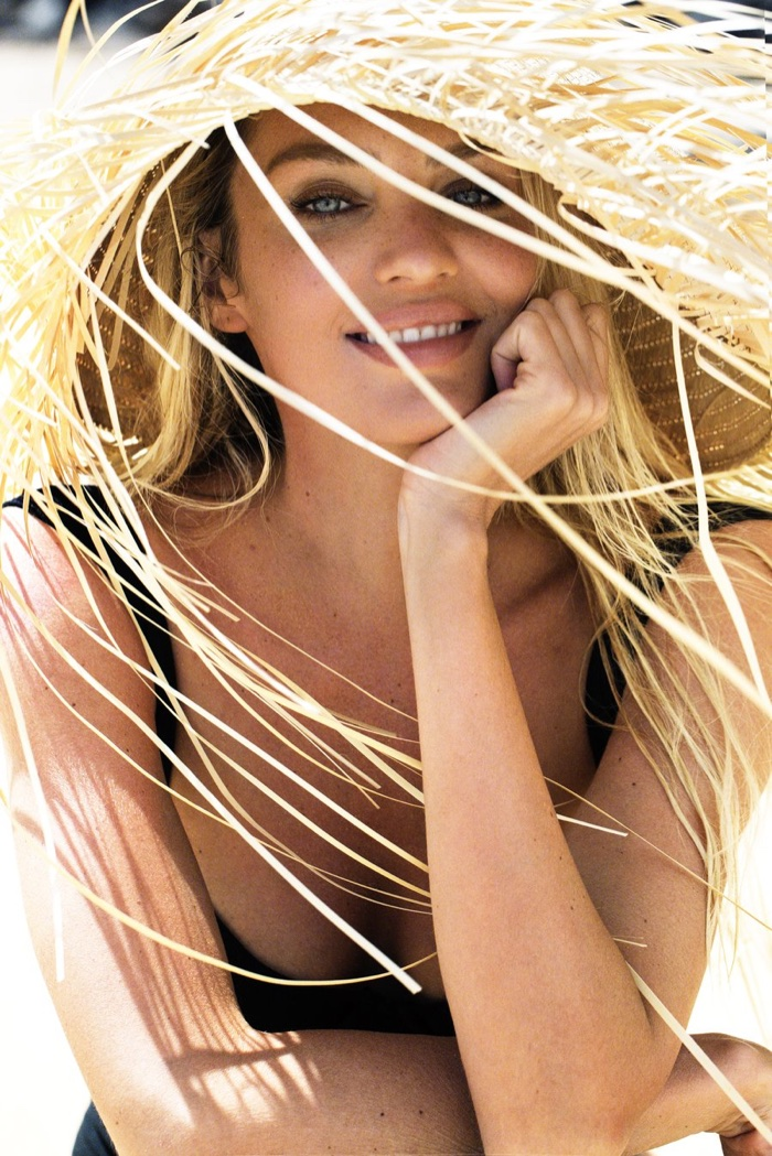 Flashing a smile, Candice Swanepoel models for Tropic of C swimsuit collection