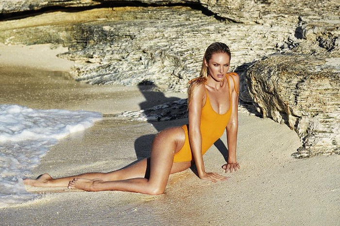 Model Candice Swanepoel wears one-piece swimsuit from Tropic of C
