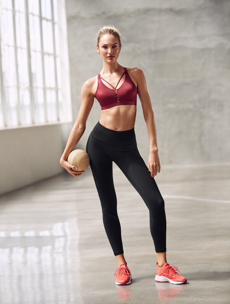 Candice Swanepoel shows off her toned figure in Victoria Sport activewear