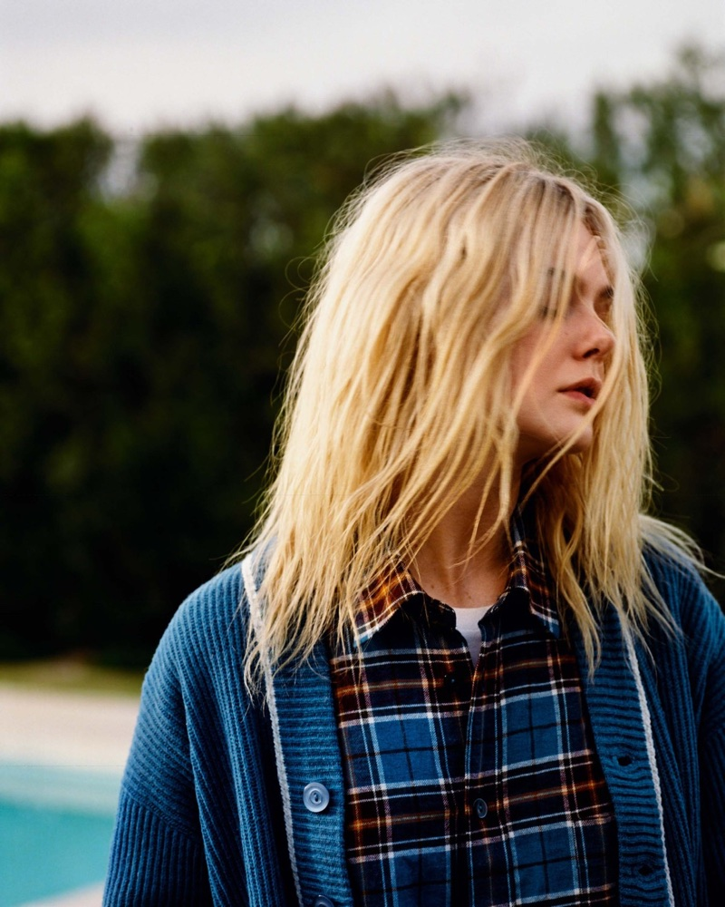 Keeping it casual, Elle Fanning wears plaid shirt and cardigan