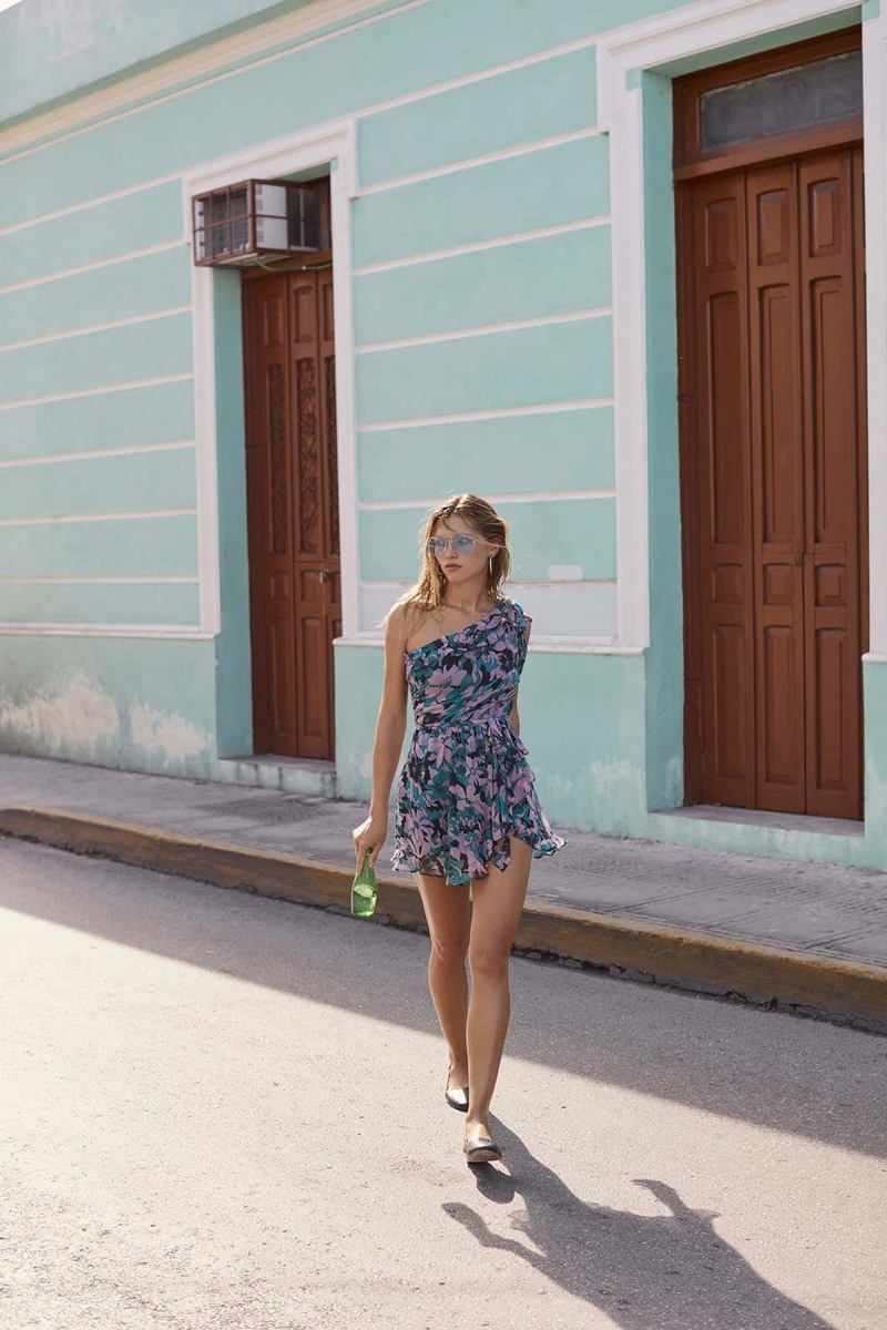 Hana Jirickova poses in printed dress from For Love & Lemons spring-summer 2018 collection