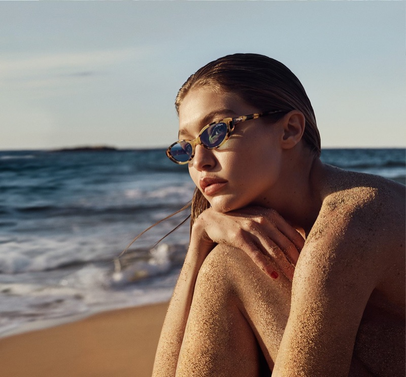 Gigi Hadid poses at the beach in Vogue Eyewear collaboration