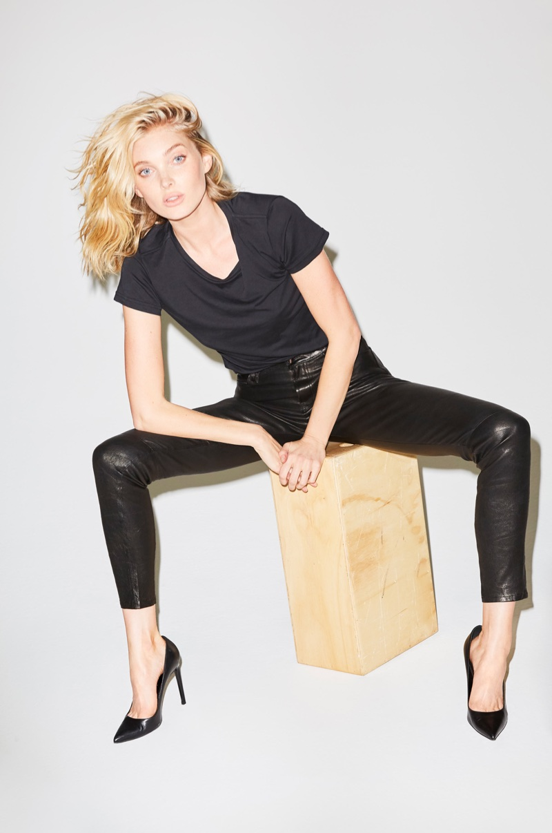 Elsa Hosk wears J Brand The Maria High-Rise Super Skinny Pant in Black Leather
