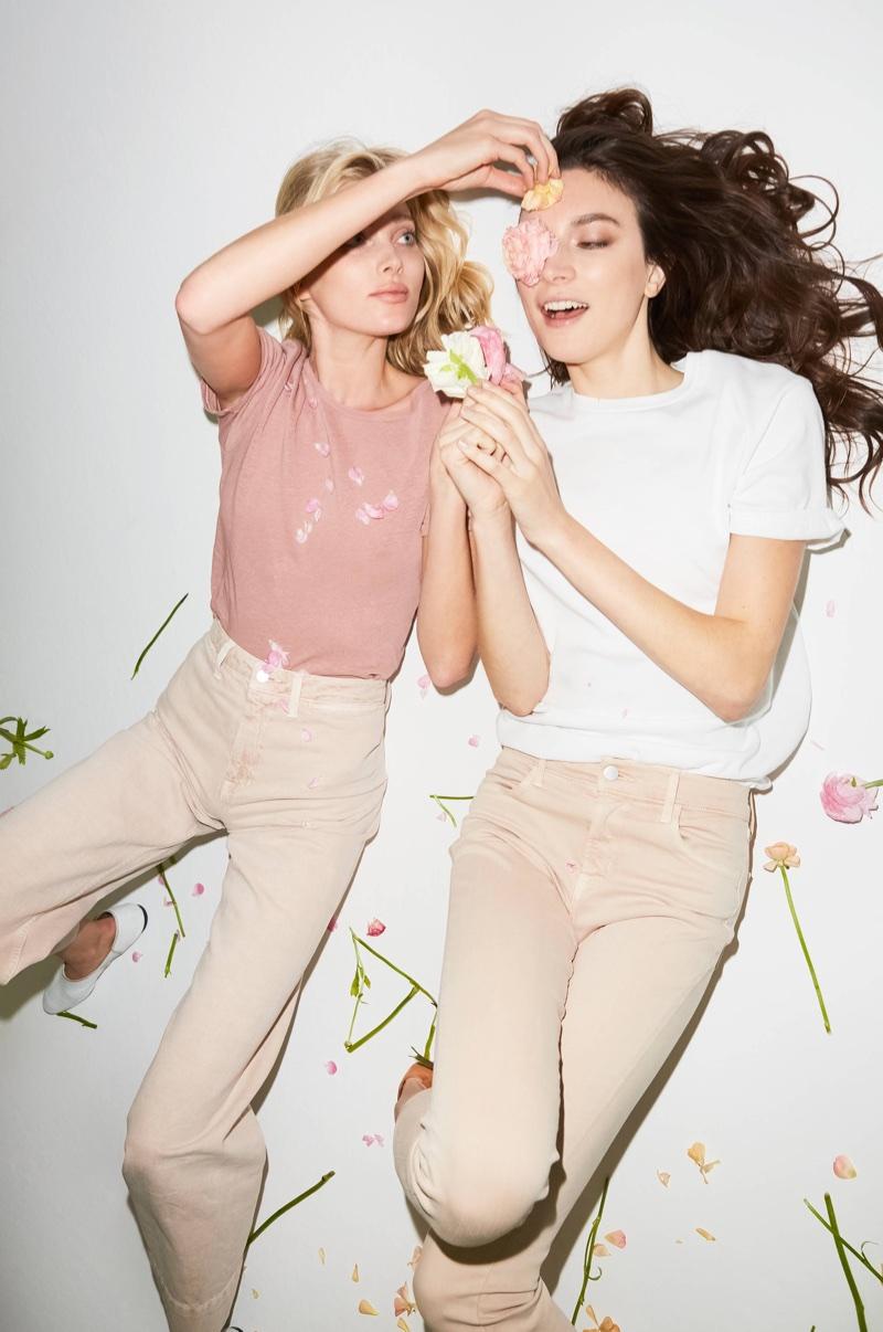 Elsa wears J Brand The Nerd Tee in Vinca and The Hallton High-Rise Jean in Memory. Jacquelyn wears J Brand The Alana High-Rise Cropped Super Skinny in Memory.