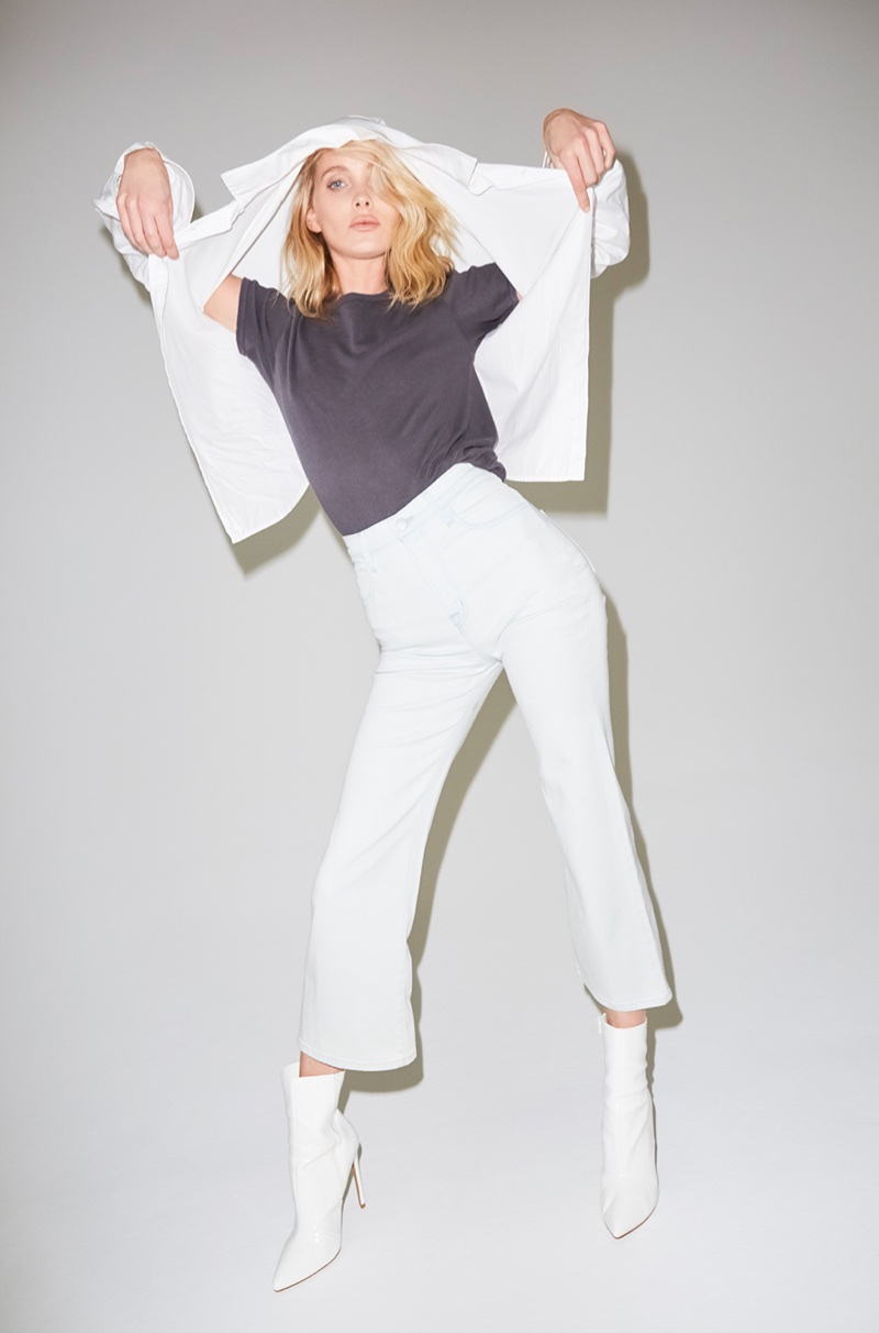 Elsa Hosk models J Brand Briley Oversized Shirt in White, Short Sleeve Grandpa Tee in Worn Iron and The Joan High-Rise Crop Jean in Powdered