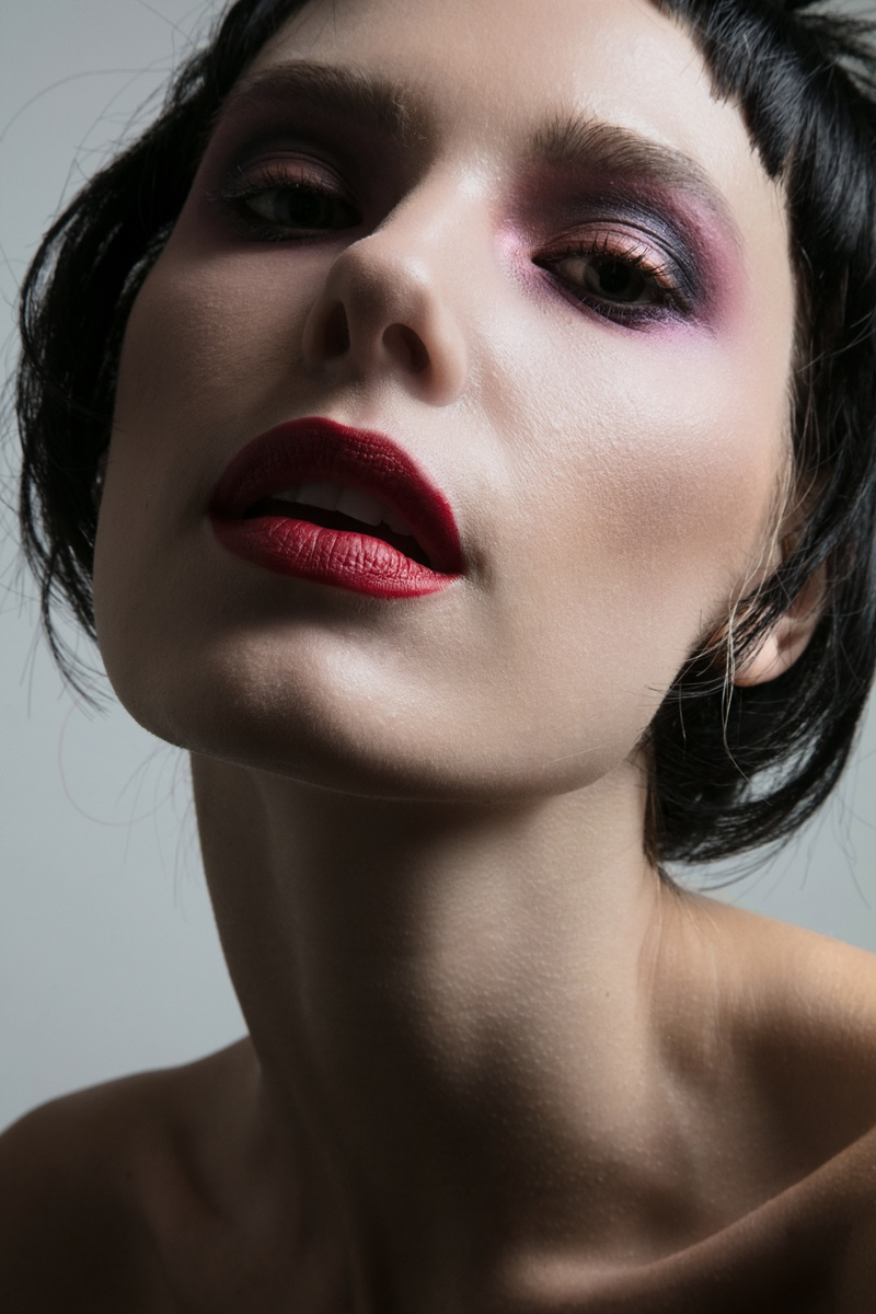 Model Jenny Savers shows off red lipstick shade. Photo: Jeff Tse