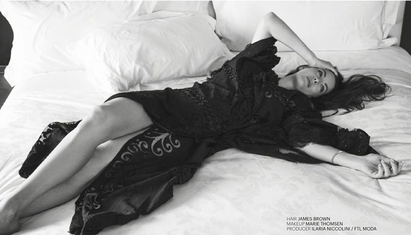 Posing in bed, Liv Tyler wears a robe