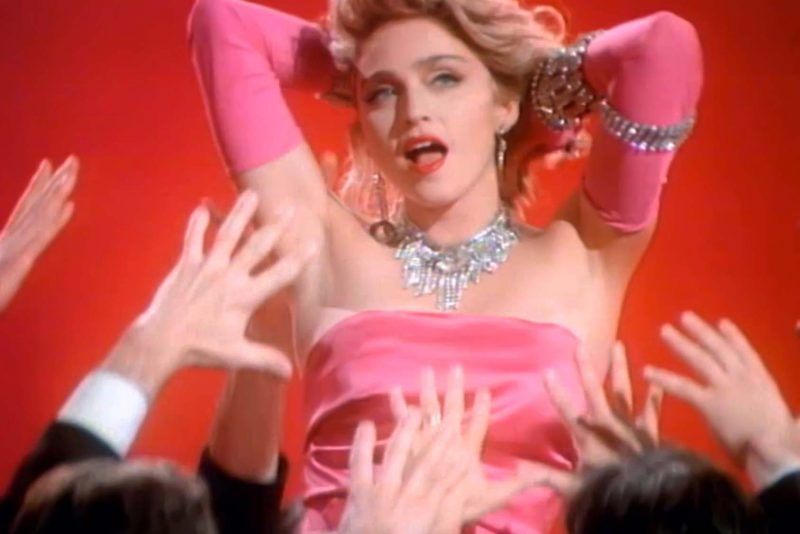 Madonna channels Marilyn Monroe for her Material Girl music video.