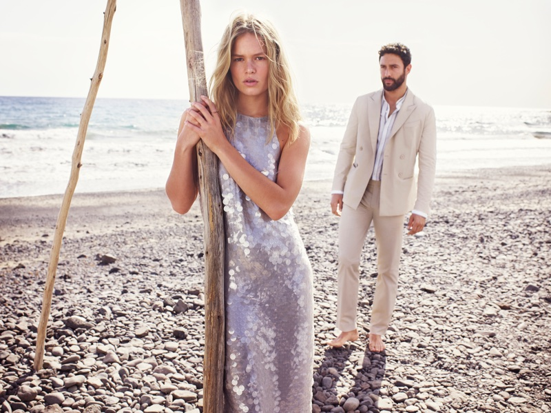 Anna Ewers and Noah Mills pose on the beach for Mango's spring-summer 2018 campaign