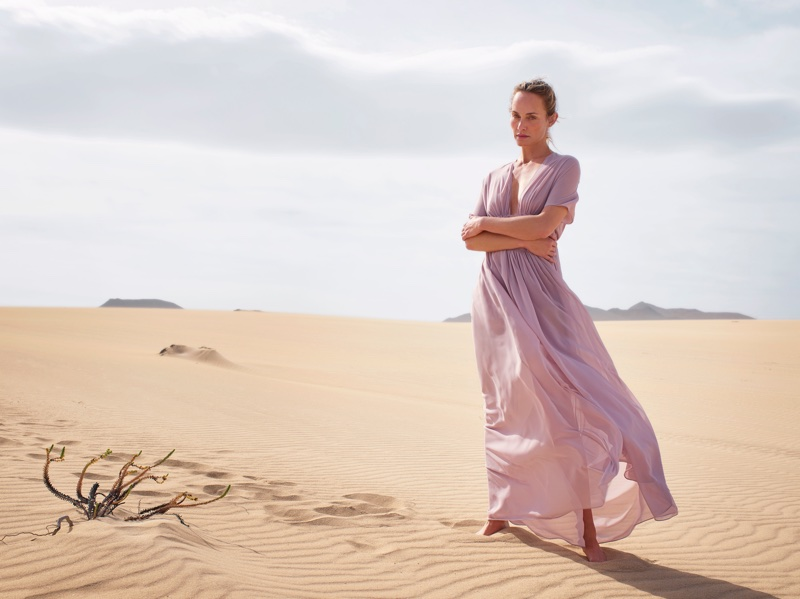 Amber Valletta poses in maxi dress for Mango's spring-summer 2018 campaign
