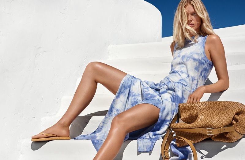 Wearing a blue dress, Iselin Steiro fronts Michael Kors' spring-summer 2018 campaign