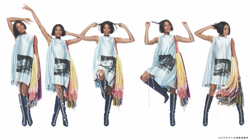 Actress Naomie Harris poses in Calvin Klein minidress and boots