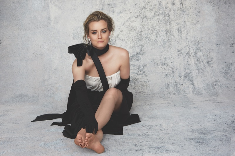Taylor Schilling wears Marc Jacobs strapless dress and Gloves with David Webb earrings