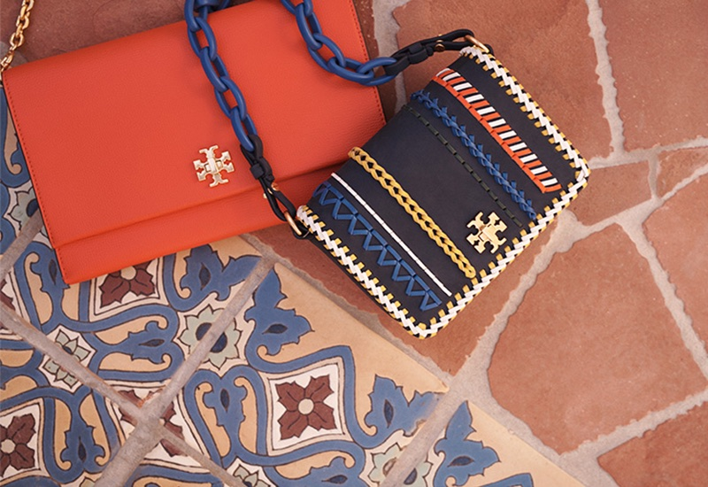 (Left) Tory Burch Kira Clutch in Poppy Orange (Right) Tory Burch Kira Whipstitch Clutch